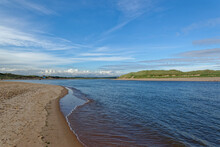 The Ythan Estuary In Aberdeenshire On The East Coast Of Scotland, Under A Big Blue Sky On A September Late Afternoon With The Tide Coming In.