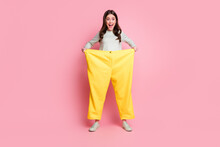 Full Length Portrait Of Funky Playful Person Open Mouth Wear Too Big Pants Isolated On Pink Color Background