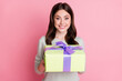 Leinwandbild Motiv Photo of wavy hairdo adorable lady hands hold giftbox toothy smile isolated on pink color background