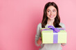 Leinwandbild Motiv Portrait of pretty curly hairstyle person arms hold giftbox look empty space isolated on pink color background