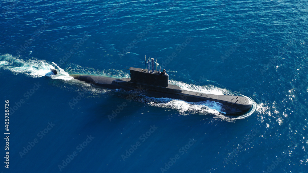 Fototapeta Aerial drone photo of latest technology Greek navy armed diesel powered submarine cruising half submerged the Aegean deep blue sea, Greece