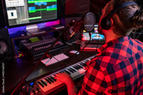 Canvas Print White young man is singing and recording a new track in the stereo studio workpl
