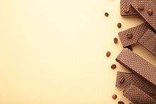 Chocolate Wafers With Coffee On Beige Background