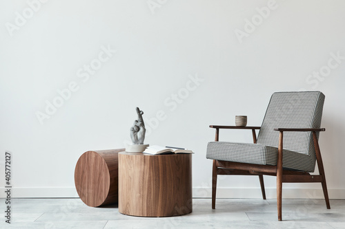 Obraz Minimalist composition of scandinavian living room with design armchair, wooden coffee tables, decoration, presonal accessories and copy space in modern home decor. Template. - fototapety do salonu