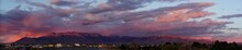 Panoramic View Of Mountains Against Sky At Sunset