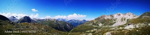 Obraz na plátně Panoramic View Of Snowcapped Mountains Against Blue Sky