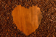Heart Made Of Coffee Beans On A Wooden Table