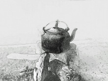 Iron Kettle Being Heated Up On A Wood Fire During Preparation Of A Local Tea