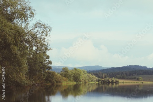 Scenic View Of Lake By Trees Against Sky #405786570