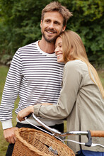 Smiling Mid Adult Couple Embracing In Garden