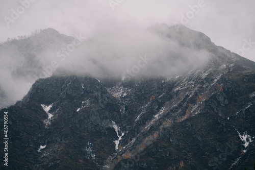 Fotografie, Obraz Clouds hung over the mountains in autumn in Altai