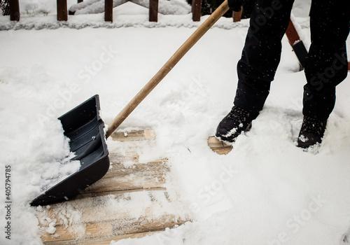 Fototapeta winter shoveling. Removing snow after blizzard obraz