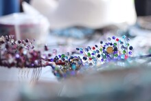 Close-up Of Multi Colored Jewelry On Table