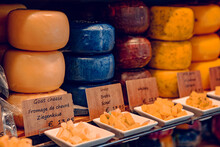 Gouda, Netherlands - July 20, 2020: Many Different Kinds Large Delicious Hunks Of Cheese On The Shelves On Sale In A Cheese Shop In Gouda
