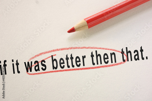Grammar or spelling mistake circled in red pencil as editor correction Fototapeta