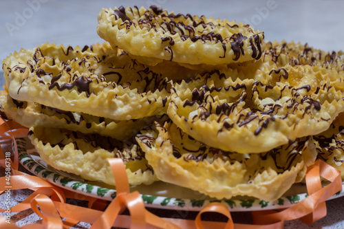 chatter or bugie, a carnival cake covered with dark chocolate Fototapeta