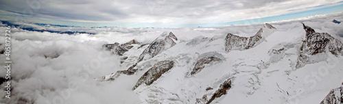 Obraz na plátně Panoramic View Of Snowcapped Mountains Against Sky