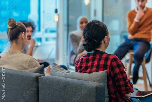 Fotografering Business meeting between multi ethnic colleagues in a modern startup company