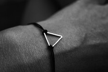 High Angle View Of Bracelet On Hand