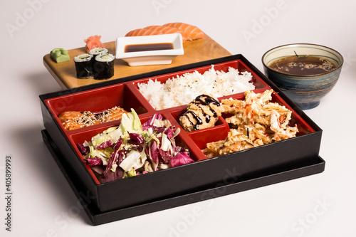 Fototapeta Japanese sushi food. Maki ands rolls with tuna, salmon, shrimp, crab and avocado, assorted sushi, all you can eat menu. Rainbow sushi roll, uramaki, hosomaki and nigiri. Portion recipe box sushi obraz