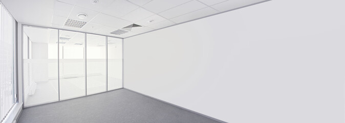 Empty office room with glass walls and glass window