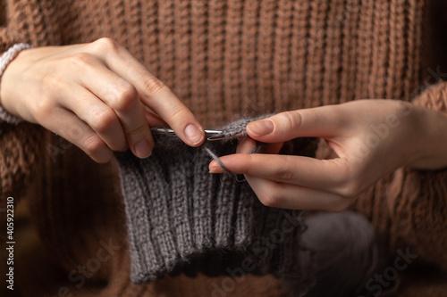 Obraz na plátně woman hands knitting wool yarn with knitting needles
