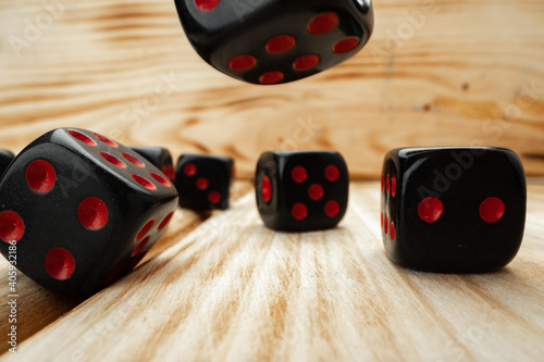 Canvastavla Macro of black tossed dice on wooden background