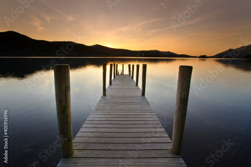 Foto Wooden Pier Over Lake Against Sky During Sunset