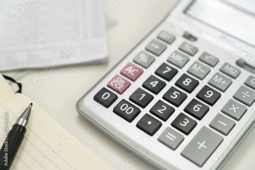 Close-up Of Calculator With Pen Over Book On Table Wallpaper Mural