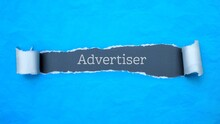 Advertiser. Blue Torn Paper Banner With Text Label. Word In Gray Hole.