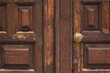 View of an old wooden door with a knob