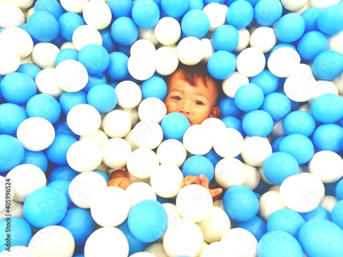 Obraz Portrait Of Boy With Ball In Blue Balls - fototapety do salonu