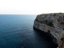 Panorama View Of Rocky Cliff Coast Shore Turquoise Mediterranean Sea Water Cala Llombards Mallorca Balearic Spain