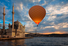 Hot Air Balloon Flying Over Spectacular Istanbul At Twilight Blue Hour - Ortakoy Mosque And Bosphorus Bridge - Istanbul, Turkey