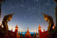 Stars Trail And Space Dust In The Universe, Long Speed Exposure At Wat Phra That Doi Phra Chan Temple, Mae Tha Lampang, Thailand.