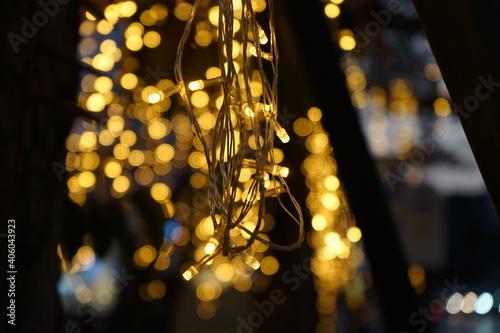 Fototapeta Close-up Of Illuminated Lighting Equipment Hanging At Night obraz na płótnie