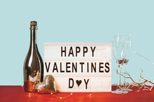Happy Valentines Day Lightbox With Golden Heart And Sparkling Wine Bottle. 14 February Greeting Card