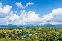 Peaceful Countryside Village And Rice Field With Beautiful Doi Phu Kha Mountain Range Scenery, Pau District, Nan Province, Thailand