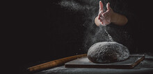 Woman Chef Hand Clap With Splash Of White Flour And Black Background With Copy Space. Woman's Hands Making Bread