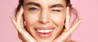 Leinwandbild Motiv Skincare and beauty. Close up of smiling young woman winking at camera, touching shiny healthy skin, nourished face after tea tree and lemon facial serum and moisturizer, pink background