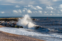 Waves Washing Up On The Rocks At West Bay In Dorset.