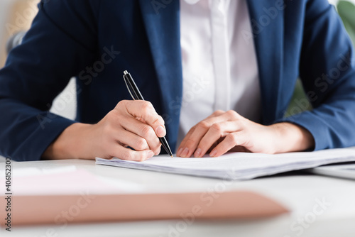 cropped view of team leader signing documents on desk - fototapety na wymiar