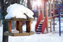 Wooden Handmade Bird Feeder On A Clear And Snowy Winter Day, No Birds In The Bird Feeder