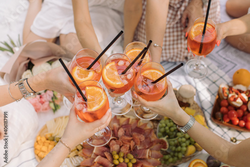 High Angle View Of Friends Toasting Drinks On Table Fotobehang