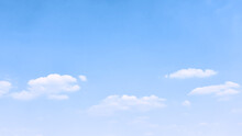 Light Blue Sky With White Clouds