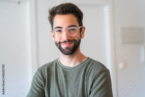 Obraz Young man smiling at home - fototapety do salonu