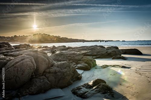 Rocks On Beach Against Sky During Sunset Fototapet