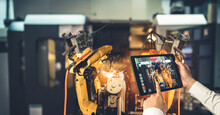 Engineer Controls Robotic Arms By Augmented Reality Industry Technology Application Software. Smart Robot Machine In Future Factory Working In Concept Of Industry 4.0 Or 4th Industrial Revolution.
