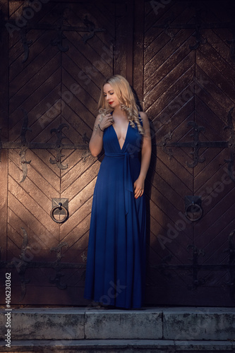 Obraz Young Woman Standing Against Wall - fototapety do salonu