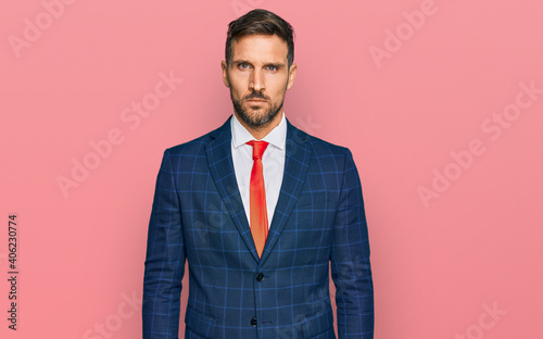 Obraz na plátně Handsome man with beard wearing business suit and tie skeptic and nervous, frowning upset because of problem